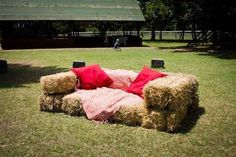 seats for ceremony made with bales of hay and decorated with a throw/pillow