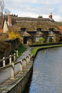 Right on the water, a chocolate box thatched roof cottage in Spring, Thornton Le Dale, North Yorkshire. England Ireland, England And Scotland, Yorkshire England, North Yorkshire, Yorkshire Dales, Visit Yorkshire, Cornwall England, English Village, English Cottages