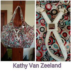 Kathy van zeeland bag Large Kathy Van Zeeland bag in a fun 60s inspired print. Side outside pockets that zip closed. Three open inside pockets and one inside zip pocket.zip top close w heart shaped kvz zipper pull. Black grey light blue red and pink. Preloved but great condition and lots of love left. Kathy Van Zeeland Bags Shoulder Bags