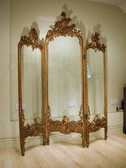 Gorgeous Victorian screen with carving and four paintings of figures