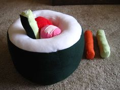 """sushi pillow. the inside """"ingredients"""" come out and can be used as individual pillows"""