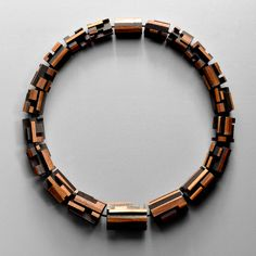 Julia Turner, Scape Necklace (Black/Brown), Walnut, stain, oxidized sterling silver, string, magnetic clasp. 21 x 7/8 x 7/8