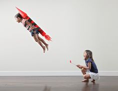 Creative dad Photoshops daughters into fun situations. Good idea for family scrapbook.