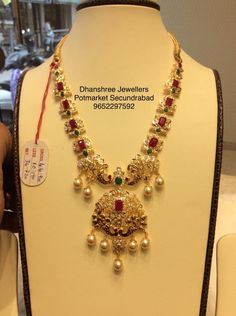 34 grams Short Haaram (BIS 91.6 Certified) . Beautiful gold necklace studded with emeralds and rubies. Necklace with pearl hangings.    27 September 2018