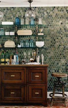 I love this look: eye catching tiles, open shelves in materials that feel fresh without taking away from the tiles.