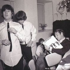 John, George, Ringo, and Brian Epstein, in a dressing room. About 1965.