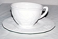 These are 40s 50s 60s era cup and saucer sets in the Harvest Grape pattern. They were made by the Indiana Glass Co. and are white milk glass. They are in nice condition with no chips or cracks.