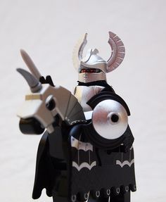"""Custom Minifigure of the Week—Grandmaster Macht Gorgonius.    Mark of Falworth created a fantastic custom #minifig this week.  The Ranger Helm wasn't designed for a knight, but Mark of Falworth transformed it so it looks perfect on top of this knight's head.  And with everything spray painted silver, he matches the designs on the #LEGO horse very well and definitely looks like the """"grandmaster.""""  Great job!"""