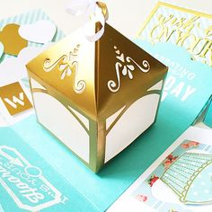 A cute cheerful and sweet box card for birthday or wedding , anniversary using  cardstock, pattern paper, pom pom, die cut, stamp, handmade card etc.It measures 4 inches by 4 inches. It can be custom colors and theme.This listing consist :- gold and tiffanyblue theme card - 2 layers- centre lighthouse with on and off switch - 1 photos corner - 1 messageChat to offer me if you need any customisation of cards, tags, album :)Thank you for viewing my listing!To search for all my Boxcard design…