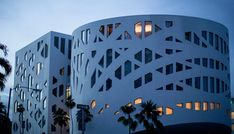 OMA claims to have taken inspiration from Frank Lloyd Wright\'s New York Guggenheim for the building\'s design, which features smooth white concrete facades. These are perforated by bands of irregularly shaped windows.