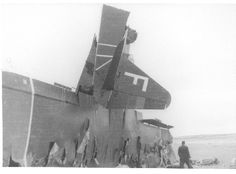 """Potez 54 con el código F """"Aquí te espero"""" de la Aviación republicana. Este aparato, pilotado por Joaquín Mellado Pascual, protagonizó un bombardeo el 22 de septiembre de 1936 sobre el Arsenal militar de Ferrol buscando hundir a los cruceros nacionales Canarias y Baleares que se encontraban en construcción en el astillero de la Sociedad Española de Construcción Naval, lo que finalmente no se produjo. Este aparato fue derribado por Ángel Salas Larrazábal el 25 de septiembre de 1936."""
