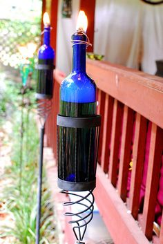 homemade wine bottle tiki torch... upcycled torch holder, wine bottle filled with citronella oil & wick holder or wire to hold the wick in place