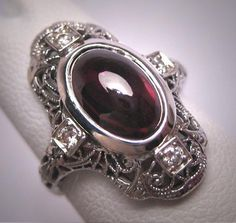 Hey, I found this really awesome Etsy listing at https://www.etsy.com/listing/535156234/antique-garnet-cabochon-diamond-ring