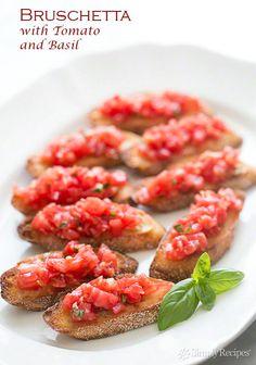 Bruschetta with tomato and basil.  Chopped fresh tomatoes with garlic, basil, olive oil, and vinegar, served on toasted slices of French or Italian bread. ~ SimplyRecipes.com