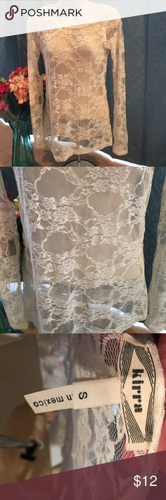 Woman's Lace long sleeve shirt 👚 🎀🎀Woman's Lace long sleeve top 🎀🎀 Ivory color. Must wear a garment under as it is see through. No stains or rips. Great condition and super cute. Kirra Tops