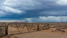 A static timelapse shot of a typical Karoo farm landscape with an old rusted gate and fence while an intense storm is approaching with dark and stormy skies or supercell clouds, South Africa. Stock Footage, South Africa, Fence, Gate, Shots, African, Clouds, Sky, Landscape