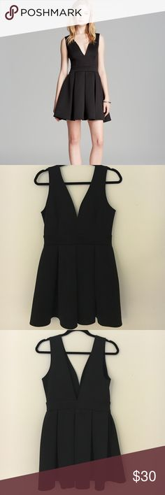 """Little Black Deep V Dress This dress is so comfortable! It's made out a neoprene/scuba material. It's classic, sexy and fun! No flaws. Never worn. The waist measured from just the front of the dress is 14"""" wide. From the top of the shoulder to the hemline the dress is 32"""" long. Armpit to armpit the dress is 16"""". The fabric is stretchy though. Alythea Dresses Mini"""