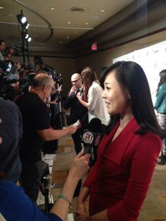 Yunjin Kim talks at the #Lost reunion at #PaleyFest2014 as co-creator Damon Lindelof is interviewed in background.