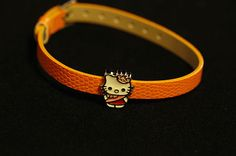 100% Brand new, good quality and very cute Hello Kitty Orange Bracelet made of man-made PU leather.  The Hello kitty Charm slider is made of alloy, is surface treated with enamel & is pink, Red &