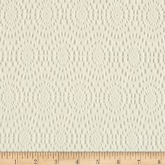 Doily Lace Ovals Ivory from @fabricdotcom  Delicate and classic, this lofty lace is soft and sheer with no significant stretch. This lace fabric appropriate for lingerie, overlays on skirts or dresses, feminine apparel accents, and wraps or shrugs.