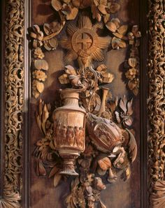 Details of lime wood carving in the Carved Room at Petworth. The classical vases on the east wall by Grinling Gibbons.