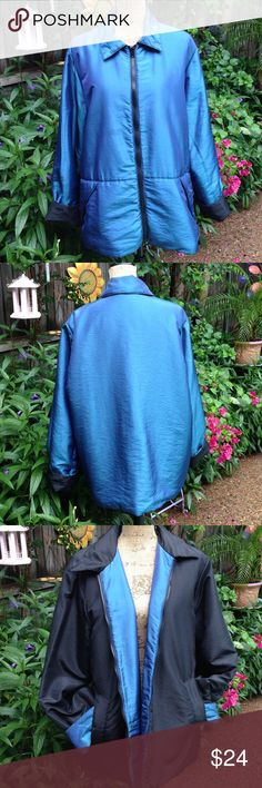 Coat Beautiful, and warm coat. Reversible, and water resistant. Perfect for cold football games. Zip front. Pretty slate blue reverses to black. 100% polyester insulation. Shell and lining of coat 58% nylon, 42% polyester. Excellent condition. Travelsmith Jackets & Coats