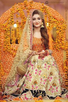 Mehndi is the memorable event in whole wedding. Brides need to chose the best bridal wear on her momentous day. Here is some latest mehndi dresses collection of 2016 and 2017 for Asian brides especially Pakistani and Indian. Pakistani Mehndi Dress, Bridal Mehndi Dresses, Pakistani Wedding Outfits, Pakistani Bridal Dresses, Pakistani Wedding Dresses, Bridal Lehenga, Mehendi, Eid Dresses, Mehndi Outfit