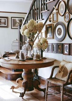 Farmhouse Entryway. Love the round table. Should I get mine back from Mom and Dad?
