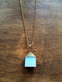 Simple I | Opalite 14k gold plated cube pendant on lightweight gold plated chain | #wearUniquely #simple #simpleLine #gold #opalite #white #cube #long #necklace www.doxahlogy.com www.instagram.com/doxahlogy