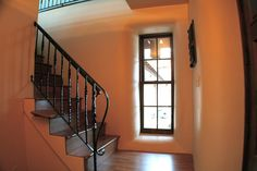 Stairs inside StrawBale House with American Clay Plaster by American Clay Enterprises, via Flickr