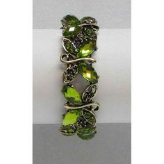 Bracelet extensible de couleur bronze serti de cristaux jaunes, violets ou verts.