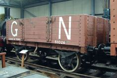 GNR 8 ton 4-plank Open Wagon No. 512026 - This is a typical wagon of its day, provided with grease axle boxes, no automatic brake and a handbrake on one side only - an arrangement that increased the risk to shunting staff needing to apply the brake on a moving vehicle.
