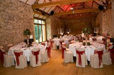 The beautiful Notley Abbey, glass vase designs created by www.wildorchidweddingflowers.co.uk
