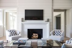 Hampton Horse Country home over looking polo fields. Living room with custom fireplace and black & white decor accents.