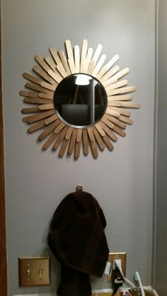 DIY Sunburst mirror painted gold jumbo craft wood sticks. A little larger than a tongue depresser. Hot glue and spray paint! About  $5.00 with spray paint under your kitchen sink collecting dust. Simple