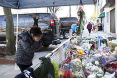 Barbara Rosenwald visits the makeshift memorial outside the home of slain NYPD Officer Wenjian.