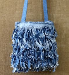 Fringe Denim Purse Handmade from Recycled Blue Jeans. It has a Single Strap in a…