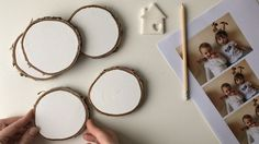 A woman paints wood slices white for this adorable belated gift idea