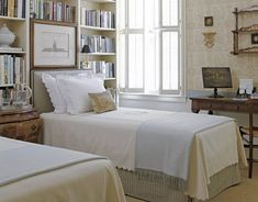 Pretty. On the bed are B. VIZ embroidered pillows, Jane Churchill sheets, and a B.D. Jeffries throw.