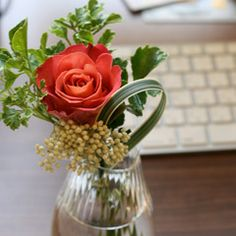 a rose at office desk