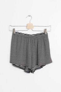 Details Size Shipping • 96% Rayon 4% Spandex • High rise shorts with elastic waist band • Hand Wash • Line dry • Made in the U.S.A • Measured from small • Waist