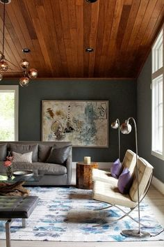 Richness of earth tones. Deep warm wood-planked ceiling and muted moss green walls. Mid century modern