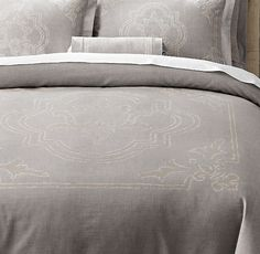 RH's Italian Baroque Medallion Duvet Cover:One of Italy's most famed ateliers prints our bedding with masterful skill and expert care. The Baroque-inspired medallion and vine borders are printed on richly textured cotton and then tailored with precision. A faded and distressed finish enhances the vintage, antiqued look and ultra-soft feel.