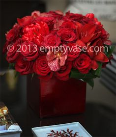 Red roses, red amaryllis, red vanda orchids, red tulips.