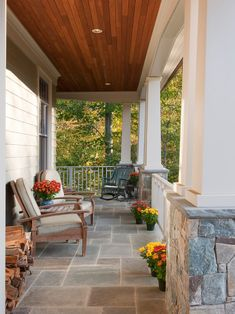 Love this front porch with beautiful ceiling, stonework, railings and columns....