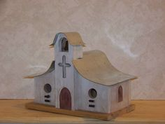 This two compartment Southwestern style birdhouse is made from ruff sawed cedar, with a tin roof and washed with exterior laytex paints. Washing with paints gives it an old look. It measures about 13long, 10-5/8 high, and 8 wide.