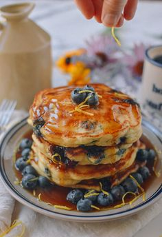 Blueberry Pancakes covered in farm fresh blueberries is a great way to enjoy blueberry season and we made it easy by sharing our time tested family recipe.