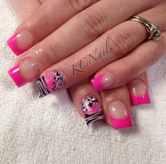 What Happens in Vegas. Hot pink acrylic french tip nails. With white, pink and glitter accent nail. Lipstick nail shape & hand painted zebra print nail art.  KCNails