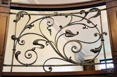 Wrought iron railing .