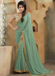 Shriya Saran See Green Zari Work Lace Border Georgette  Party Wear Designer Sarees http://www.angelnx.com/Sarees/Bollywood-Sarees#/sort=p.sort_order/order=ASC/limit=32/page=3